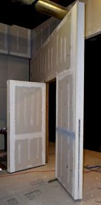 Pivot door wall with hidden door secret door man door