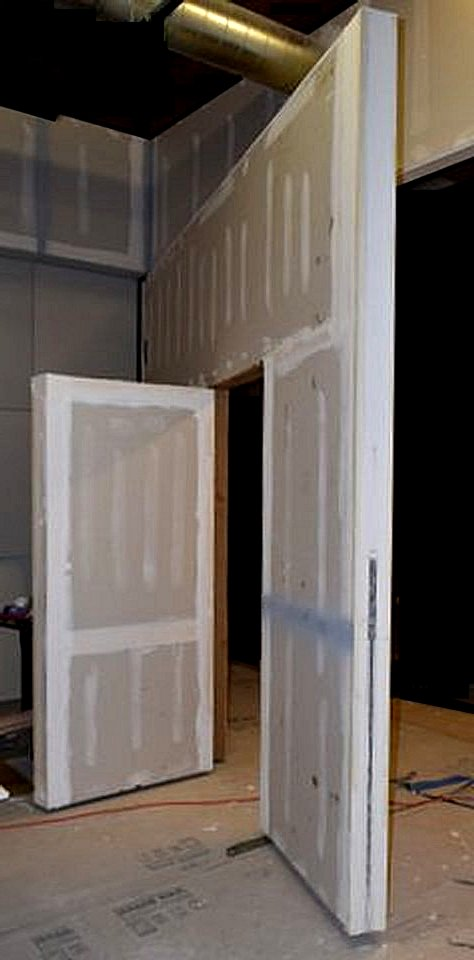 Pivot door wall with hidden door secret door man door & Pivoting Secret Door | Pivot Door Inc pezcame.com