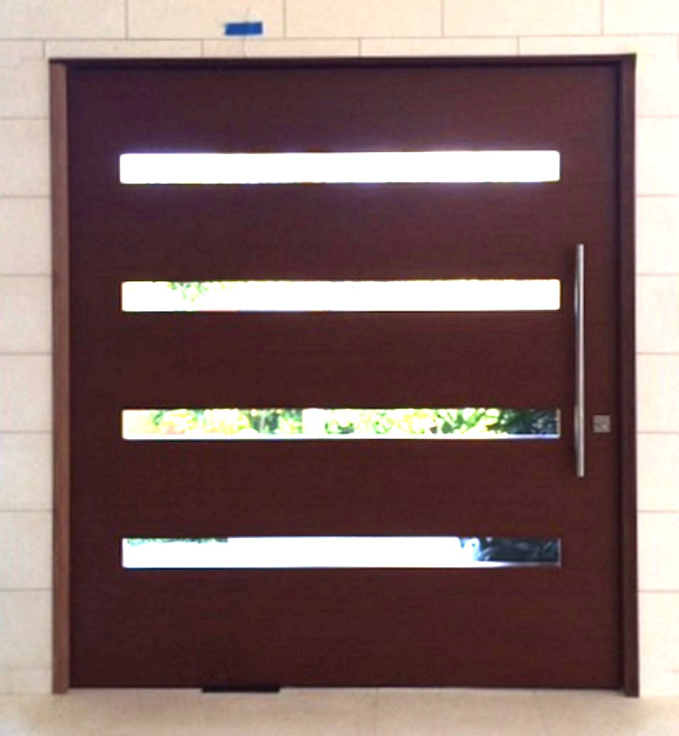 Stainless steel pivot doors pivot door inc for Exterior wood doors for sale
